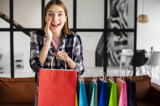 secret shopper woman holding red paper bag